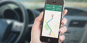 Person using mobile phone directions map application