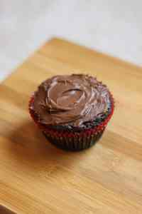 Brownie in Christmas cupcake liner with chocolate frosting.