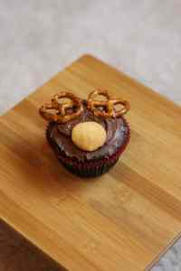 Brownie in Christmas cupcake liner with chocolate frosting,  Nilla Wafer, and pretzels for reindeer antlers.