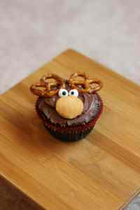 Brownie in Christmas cupcake liner with chocolate frosting, Nilla Wafter, pretzels for antlers and candy eyeballs.
