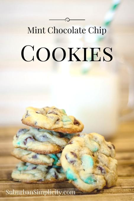 Mint Chocolate Chip Cookies stacked next to a glass of milk with a straw in it.