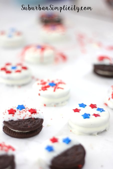 Red, white and blue patriotic Oreos on a counter.