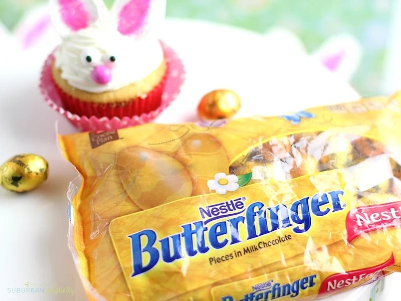 A bunny cupcakes next to a Butterfinger NestEgg package.