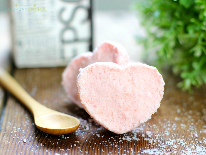 Pink heart shaped bath bombs with a spoon laying next to them.
