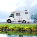 RV Camper and bikes behind it.