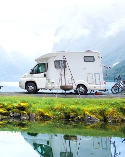 RV Camper and bikes behind it.