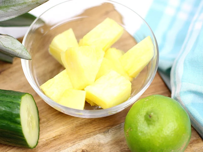 Cubed pineapple for pineapple cucumber salad.