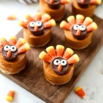 Pumpkin Pie Turkeys on a cutting board.