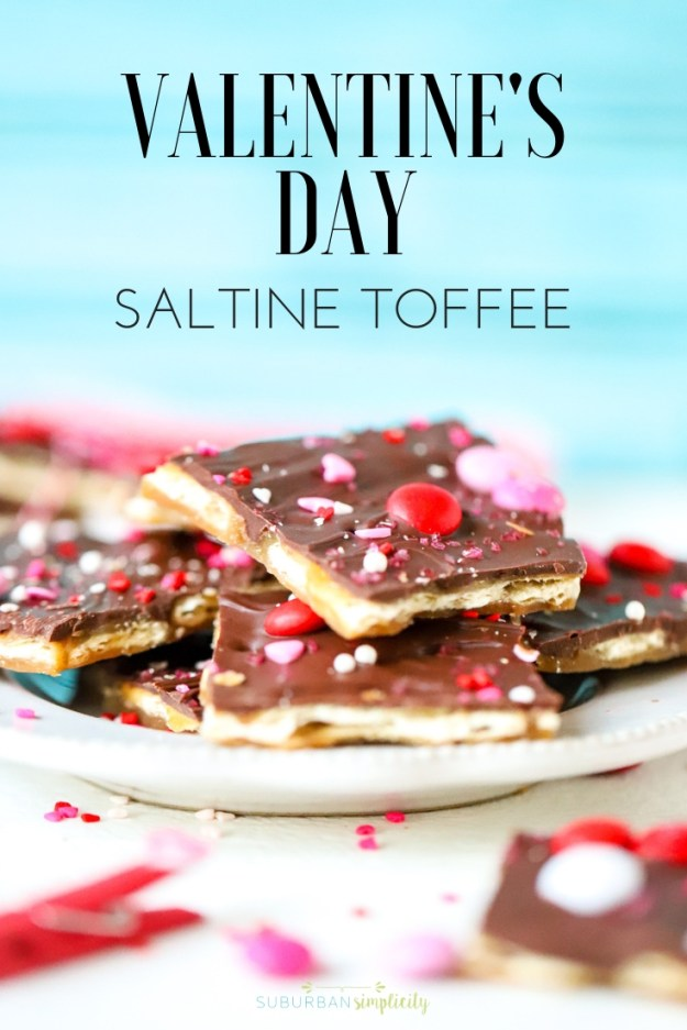 You can't resist and salty + sweet goodness of Valentine's Day Saltine Toffee! This easy and addictive candy recipe is the perfect way to celebrate Valentine's Day! #suburbansimplicity #toffee #saltinetoffee #valentinesday