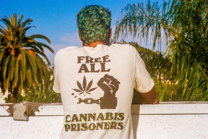 Jimi wearing last prisoner project shirt