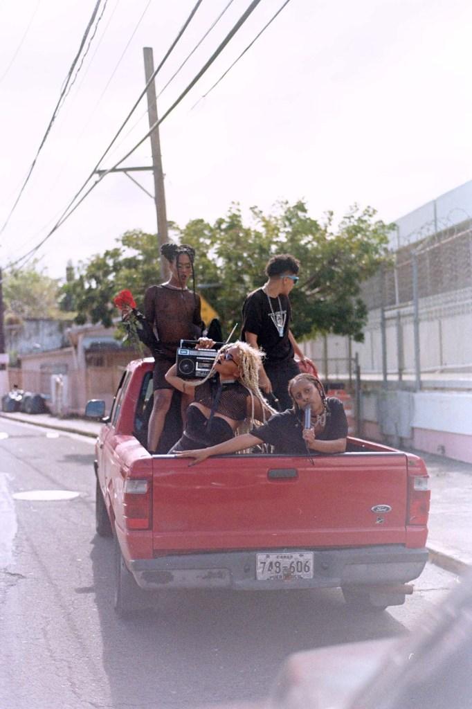 """Queer artists riding around in Moréna Espiritual's """"BEBECIT"""" video."""