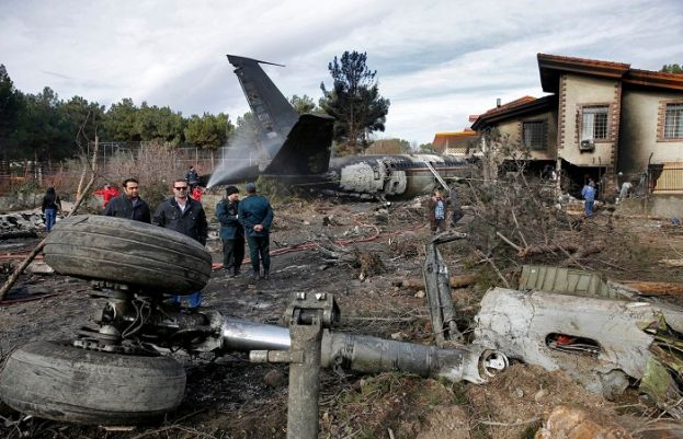This photo provided by Mizan News Agency, shows Iranian rescue personnel and security work at the site of a Boeing 707 cargo plane crash, at Fath Airport about 40 kilometers (25 miles) west of Tehran, Iran, Monday, Jan. 14, 2019. An Iranian emergency management official has told state TV that 16 people were on board a Boeing 707 cargo plane that crashed west of Tehran and that there is only one known survivor.