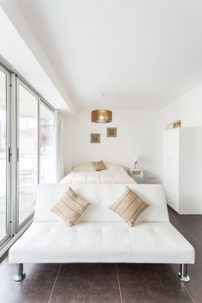 Apartemento amoblado con balcon superior sillon cama