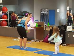 Teaching a barre class with my toddler by my side