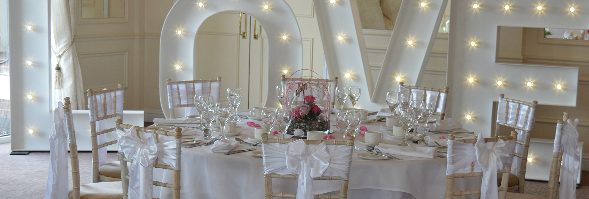 chair covers wedding costs old fashioned rocking neopets ipswich suffolk white chiavairi chairs with shashes and iluminated sign