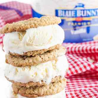 These Oatmeal Ice Cream Sandwiches are made with a creamy vanilla ice cream sandwiches between two chewy spiced oatmeal cookies.