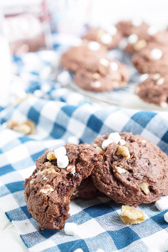 These Rocky Road Pudding Cookies are loaded up with chocolate chips, walnuts, and marshmallows and have a soft and chewy brownie-like center!
