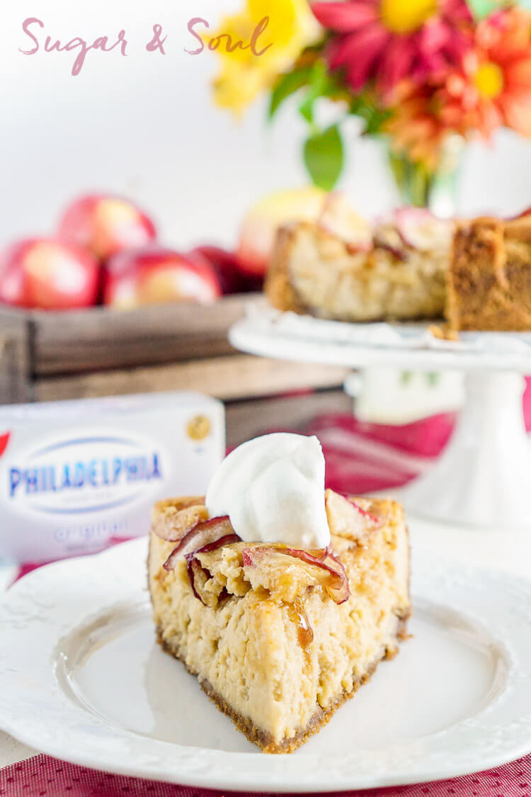 This Maple Cheesecake with Roasted Apples is rich and creamy and loaded with fall flavor! It's a grand addition to the holiday table, especially if you're looking to impress with taste and presentation!