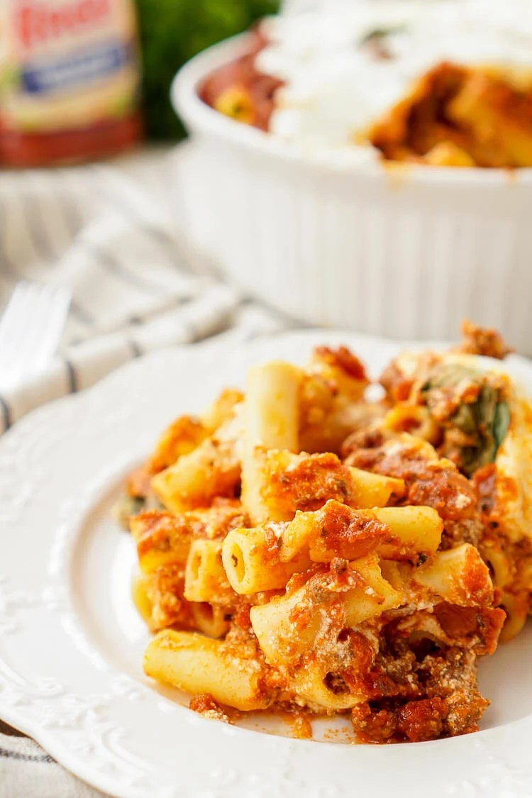 This Baked Ziti Recipe is a classic homestyle dish that's just waiting to be devoured! Tender pasta, melted cheese, meat, and a hearty sauce come together for the ultimate comfort food!