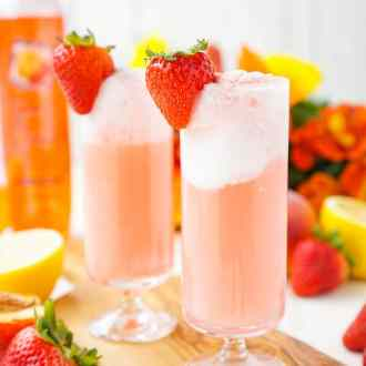 These Strawberry Lemonade Floats are an instant summer classic! Sweet and tart swirl together for an easy and delicious warm weather treat!