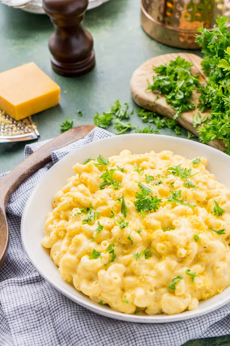 This really is the Best Ever Creamy Mac and Cheese! Made with sharp cheddar and Parmesan cheese, heavy cream and whole milk, richened with butter and kicked up with some mustard powder, you just can't go wrong! This stovetop mac and cheese recipe is on the table in just 25 minutes!