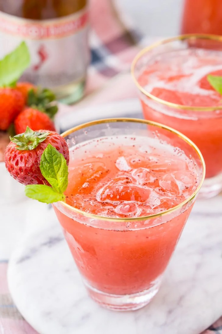 This Strawberry Champagne Punch is the ultimate pink drink! It's sparkly,  easy to make