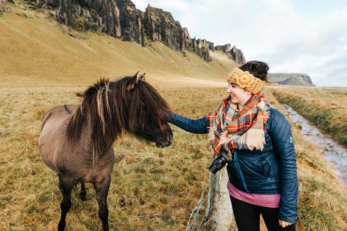 Woman petting Icelandic horse