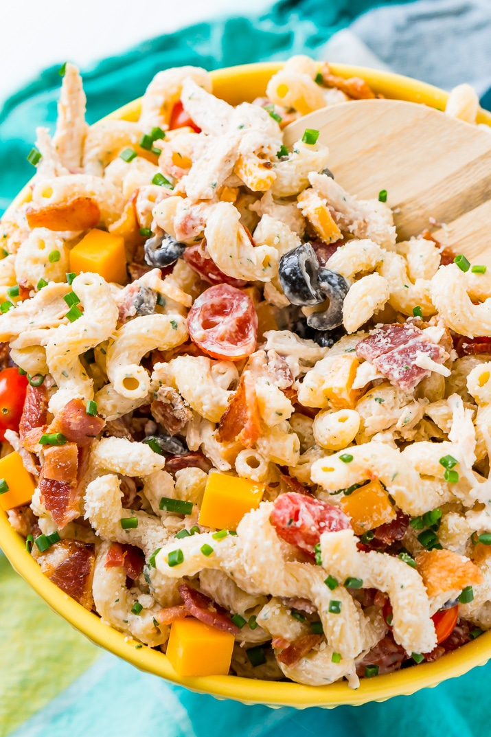 This Chicken Bacon Ranch Pasta Salad is going to be an instant hit at BBQs and picnics this summer! It's loaded with chicken, bacon, cheese, olives, and coated with a delicious ranch dressing.