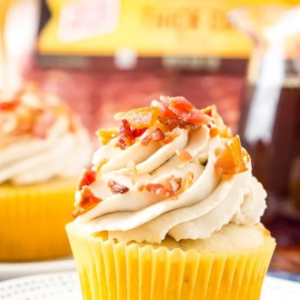 Coffee Maple Bacon Cupcakes consist of maple-infused vanilla cupcakes loaded with pieces of freshly cooked bacon. These treats are topped with a generous swirl of coffee-flavored whipped cream!