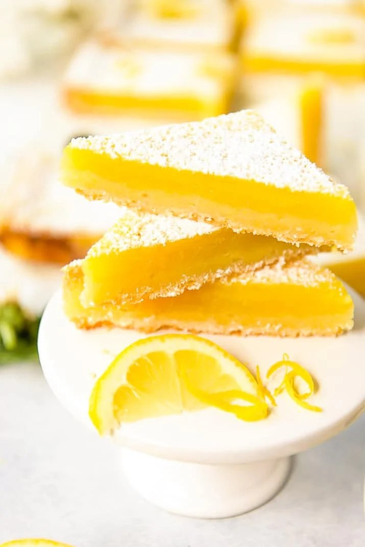 Tart lemon custard & subtly sweet shortbread make these bright and tasty Lemon Bars the perfect summer treat! These highly portable dessert bars can be cut to any size you need, and are great for all your picnics in the park, outdoor barbecues, and pool parties all season long.