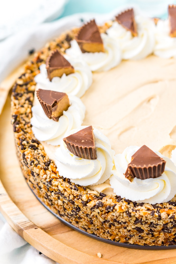 This No Bake Peanut Butter Pie is an easy and sinful dessert recipe made with a pretzel crust, a creamy peanut butter filling, and topped with peanut butter cups.