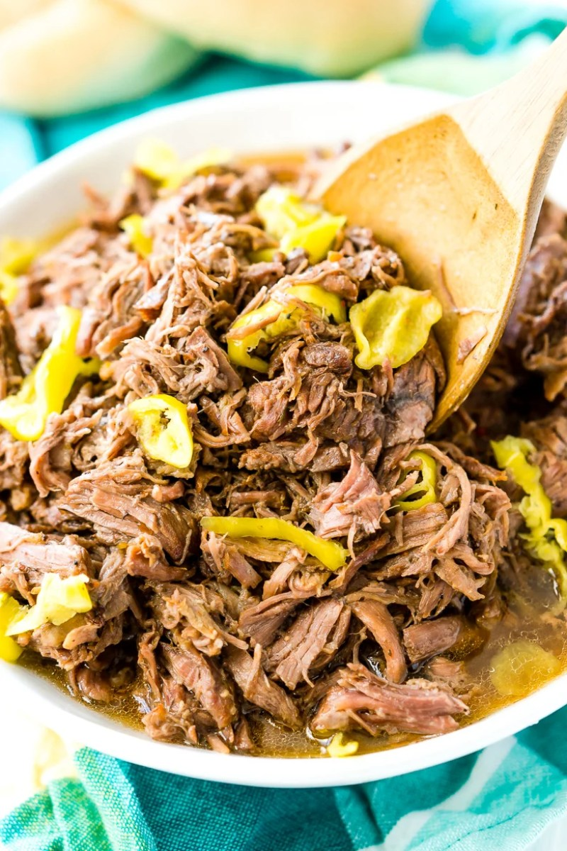 This Slow Cooker Italian Beef is an easy dinner recipe inspired by the Chicago staple that has so much flavor it will literally melt in your mouth!