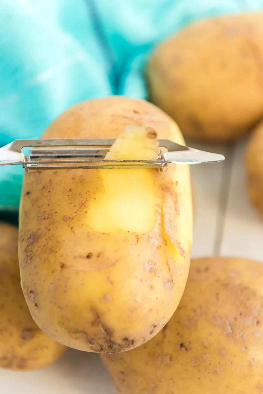 Peeling potatoes for Mashed Potatoes.