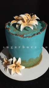 A floral blue and orange cake