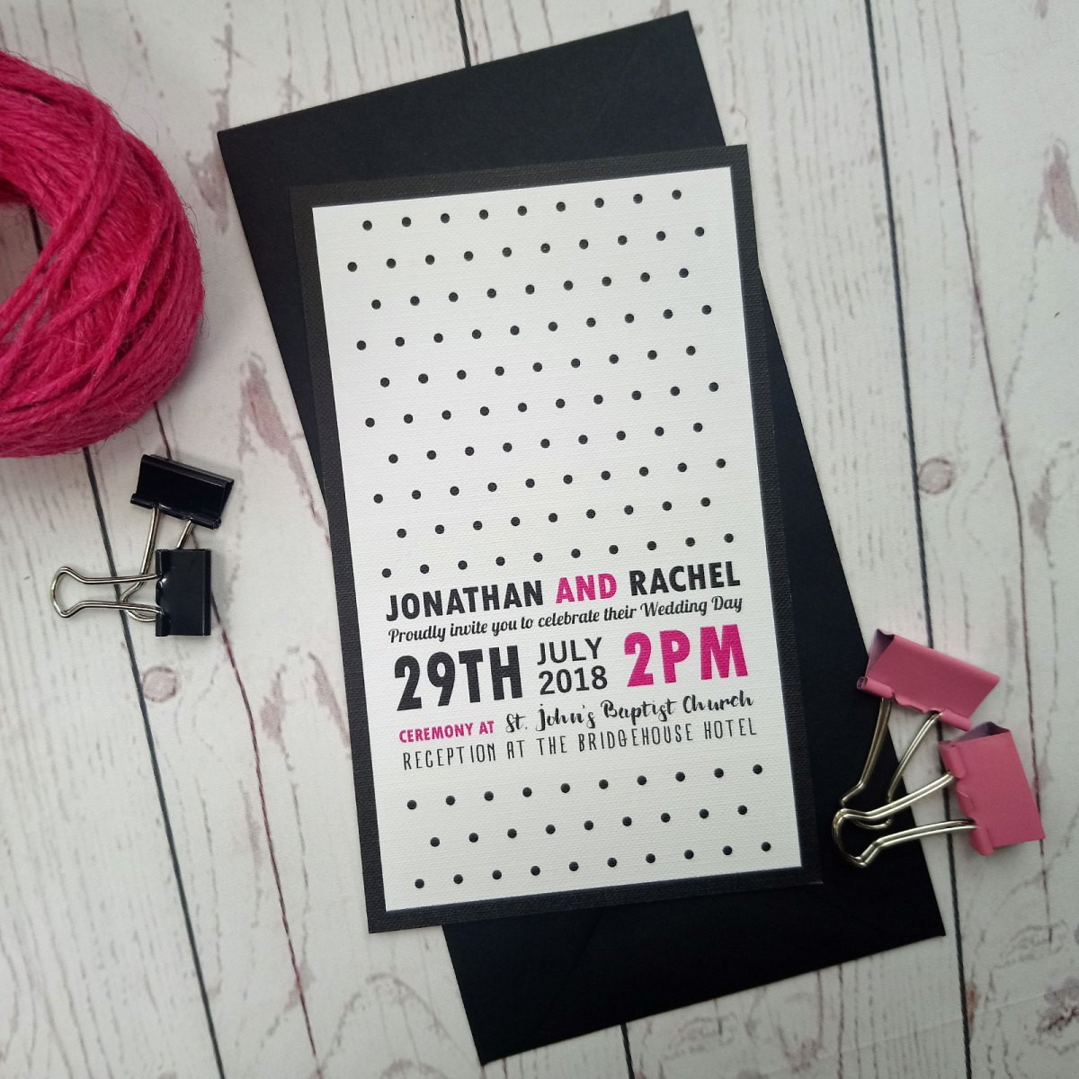 RSVP card in the classic polka dot style. Black and fuchsia font on white textured card with matching black envelope.