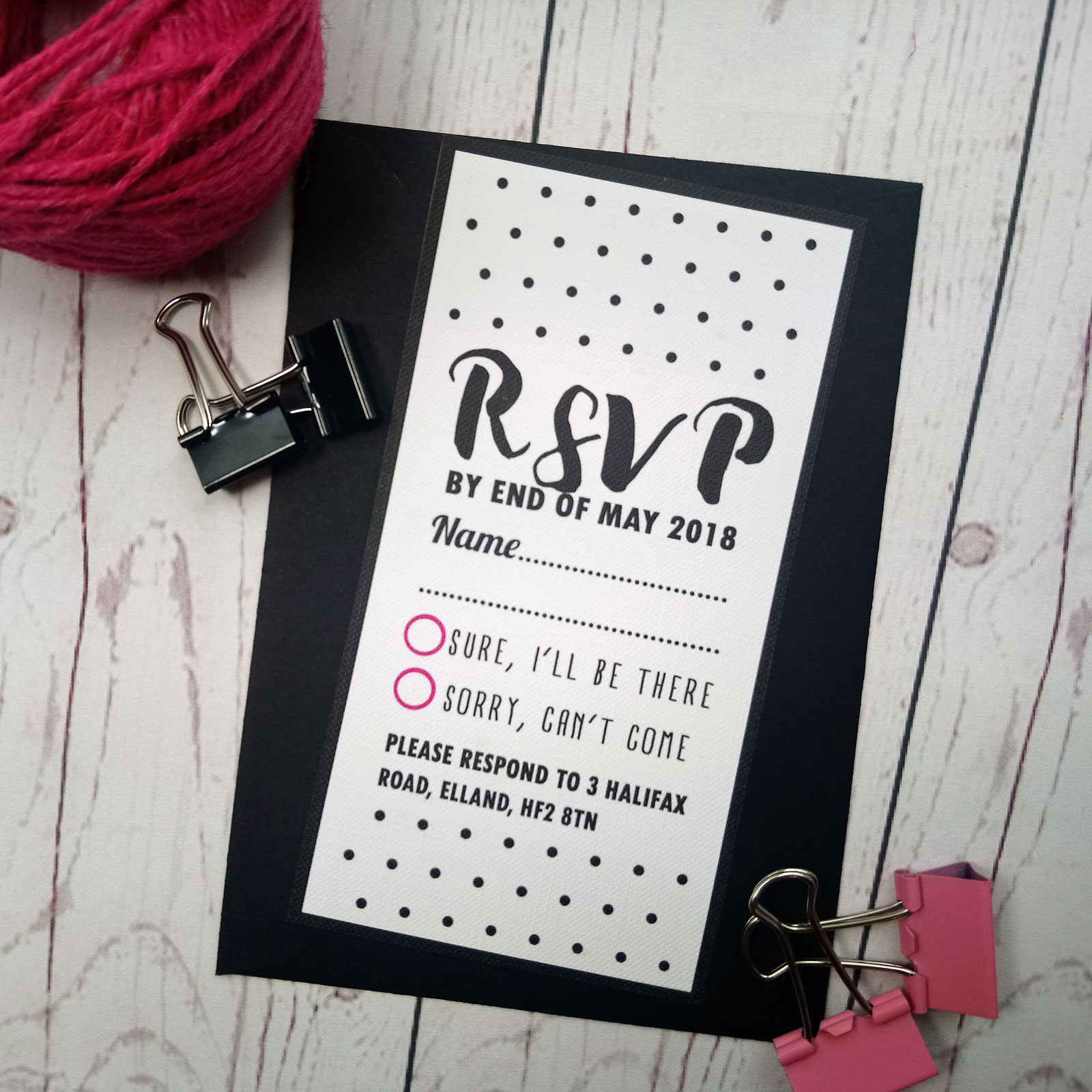 Polka dot RSVP card. RSVP card in the classic polka dot style in black and fuchsia colours with black envelope.
