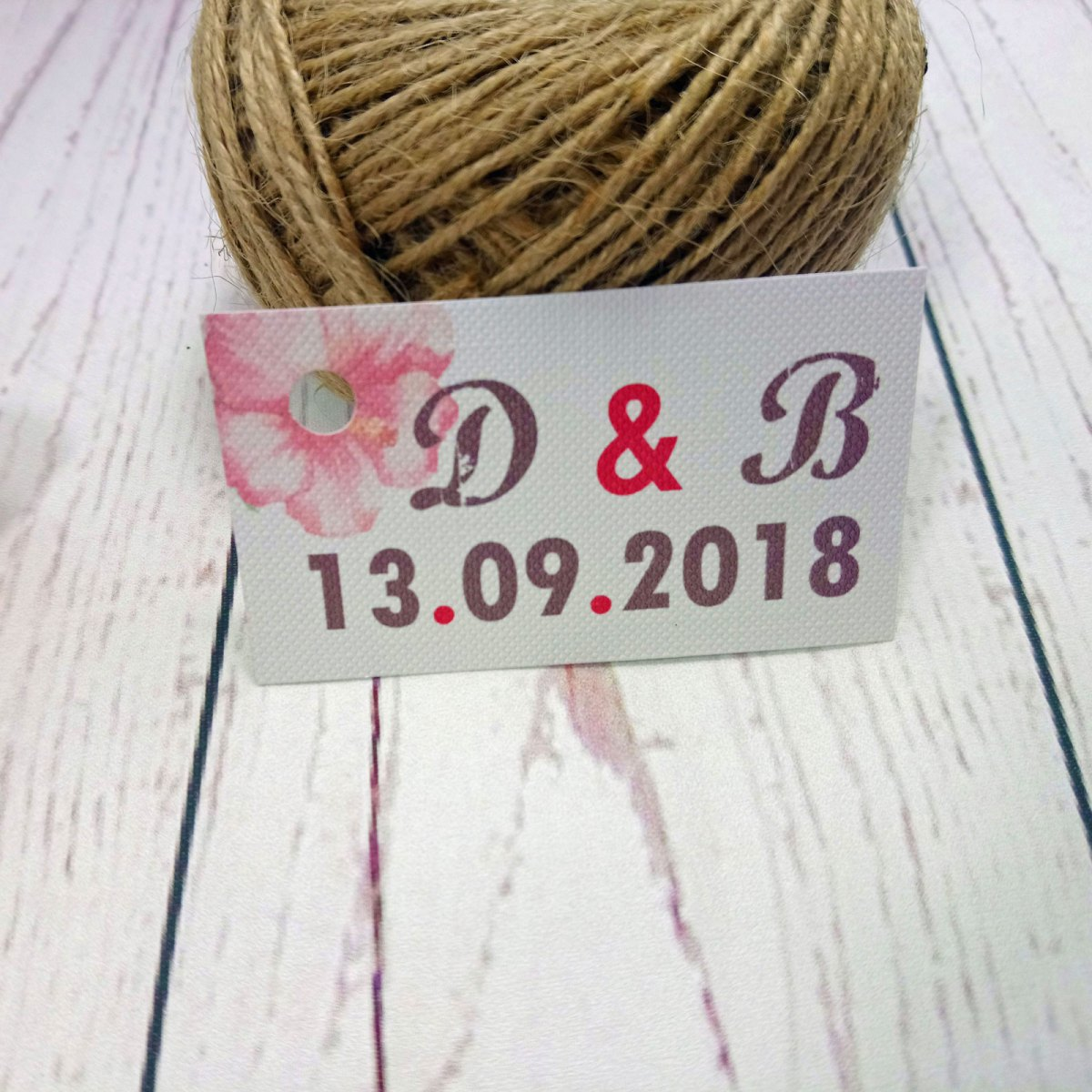 Watercolour Flowers wedding tag with hole punch with bride and groom's initials and wedding date