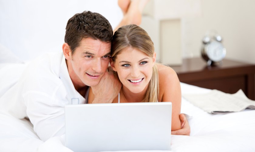 couple wedding planning on laptop