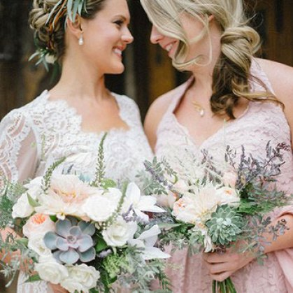 Brides holding mixed succulent wedding flowers bouquet