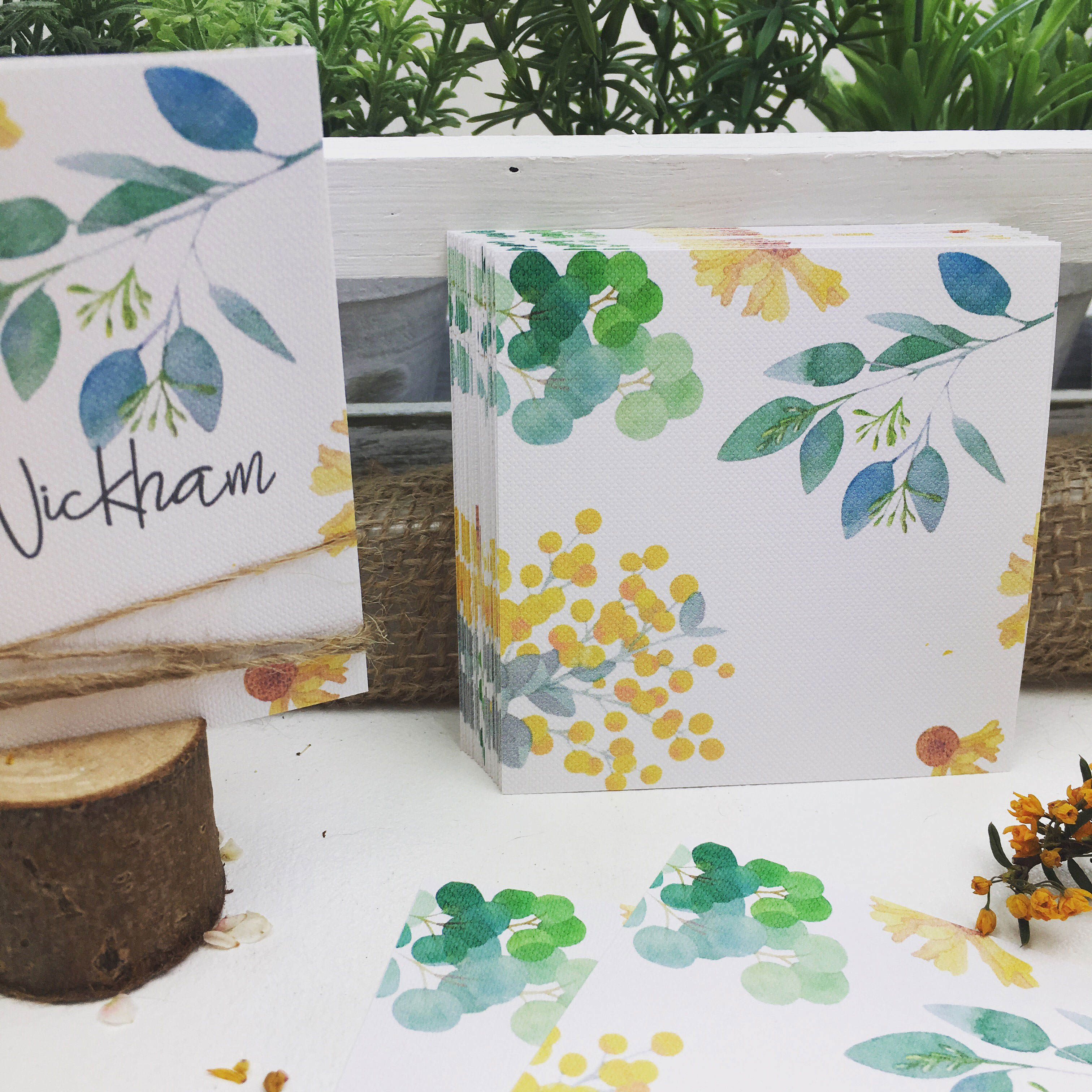 Unpersonalised yellow botanical place cards green leaves