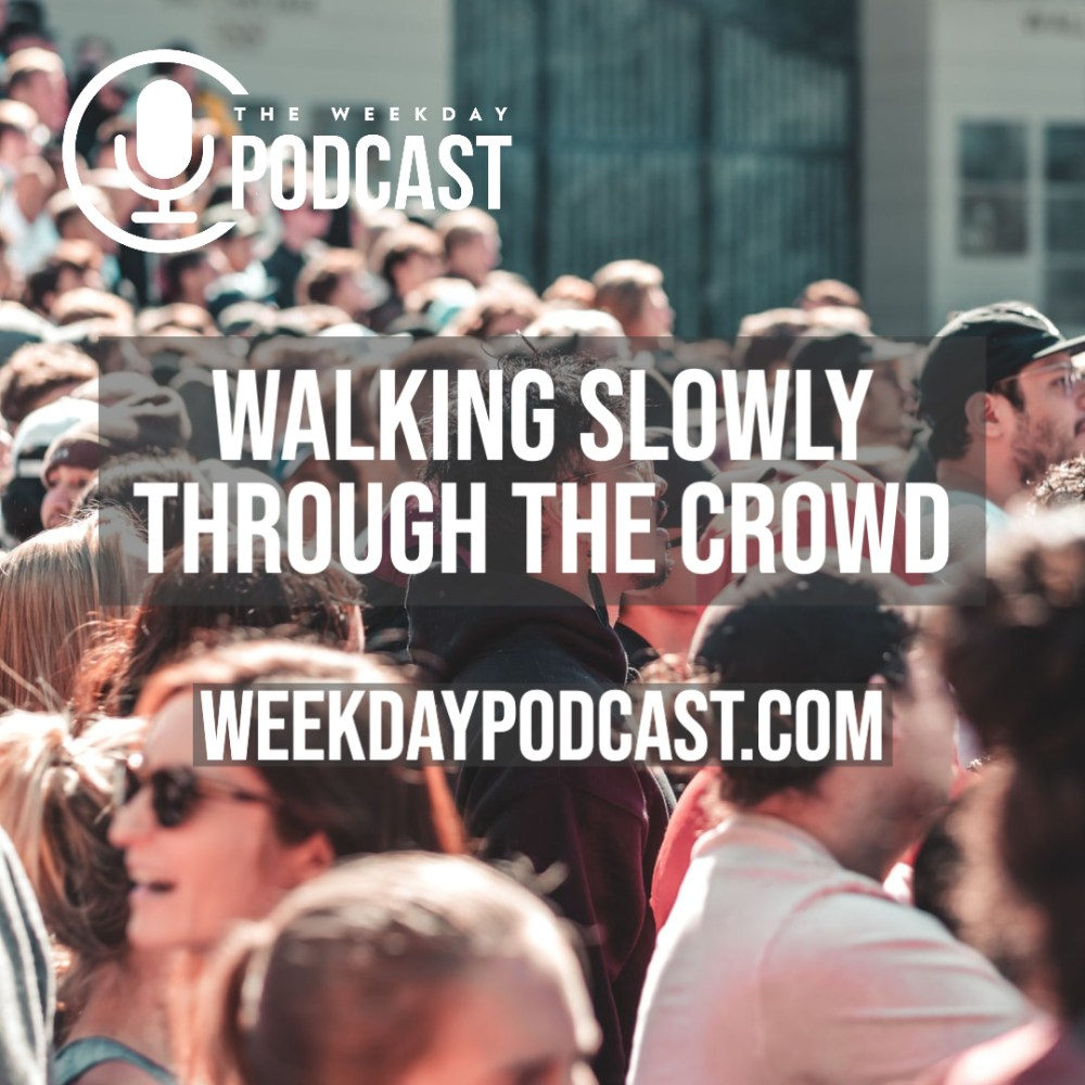 Walking Slowly Through The Crowd Image