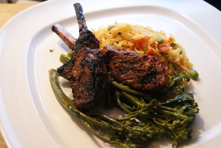Jerk Lamb with Caribbean rice and sautéed baby broccoli
