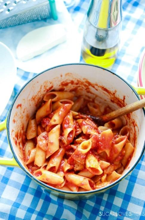 Pasta alla Norma-pasta in the sauce-stirring