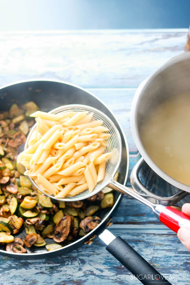 Penne with Zucchini and Mushrooms-penne in the pan