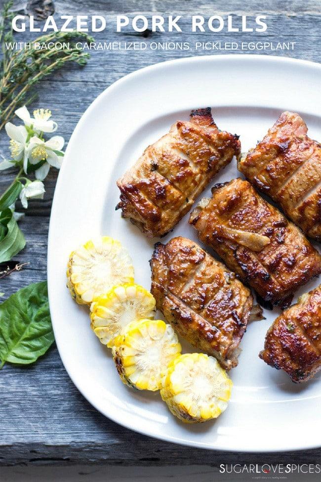 Glazed Pork Rolls with Bacon, Caramelized Onions, pickled Eggplant