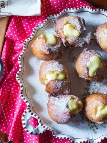 bigne di san giuseppe-puffs on a plate