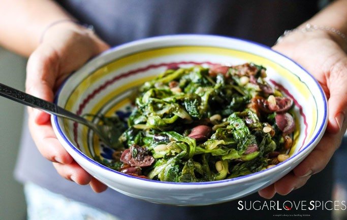 Scarola alla Napoletana-Sauteed Escarole with Olives, raisins, and Pine Nuts