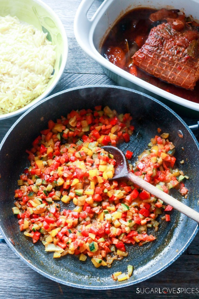 mixing vegetables in the pan