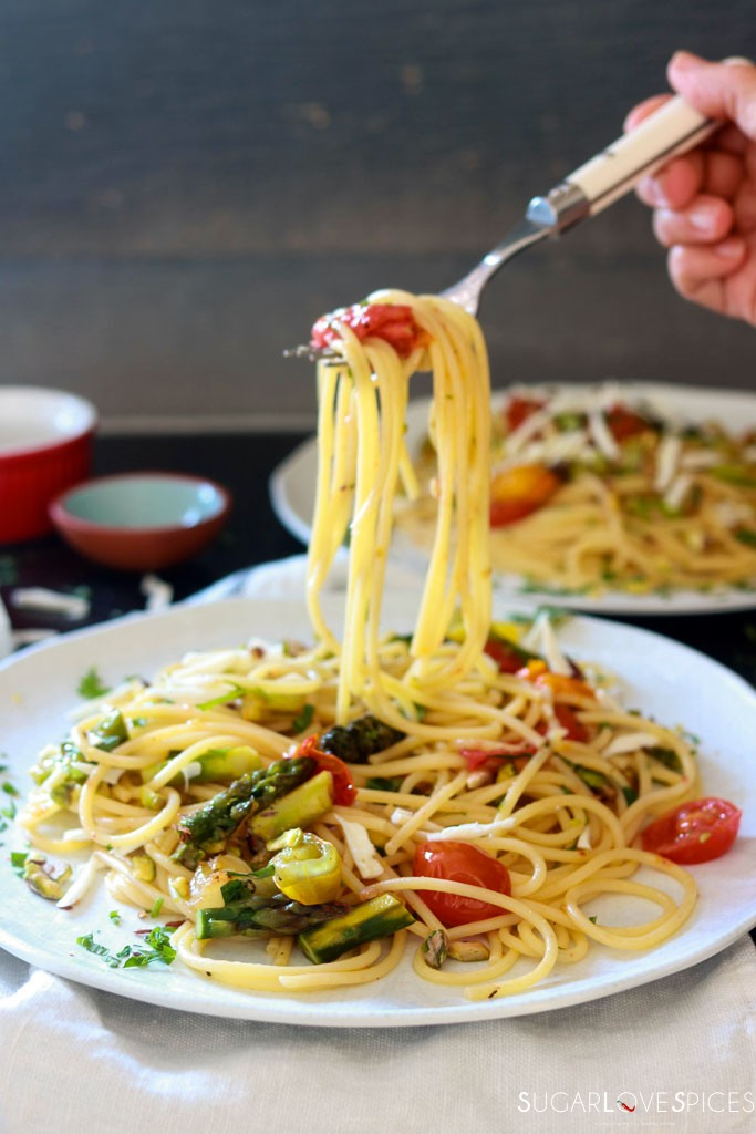 Spaghetti Primavera with Roasted Asparagus and Tomatoes-a forkful of spaghetti