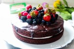 Yogurt Cream Chocolate Ganache Cake with Field Berries-frontal view